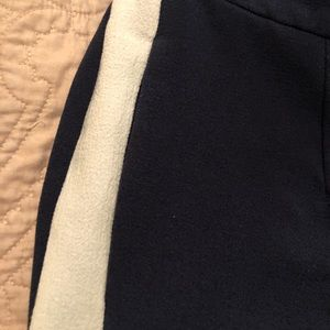 Navy blue pants with white stripe